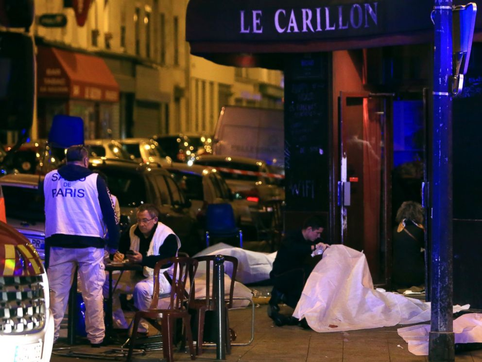 PHOTO: Victims lay on the pavement outside a Paris restaurant, Nov. 13, 2015.