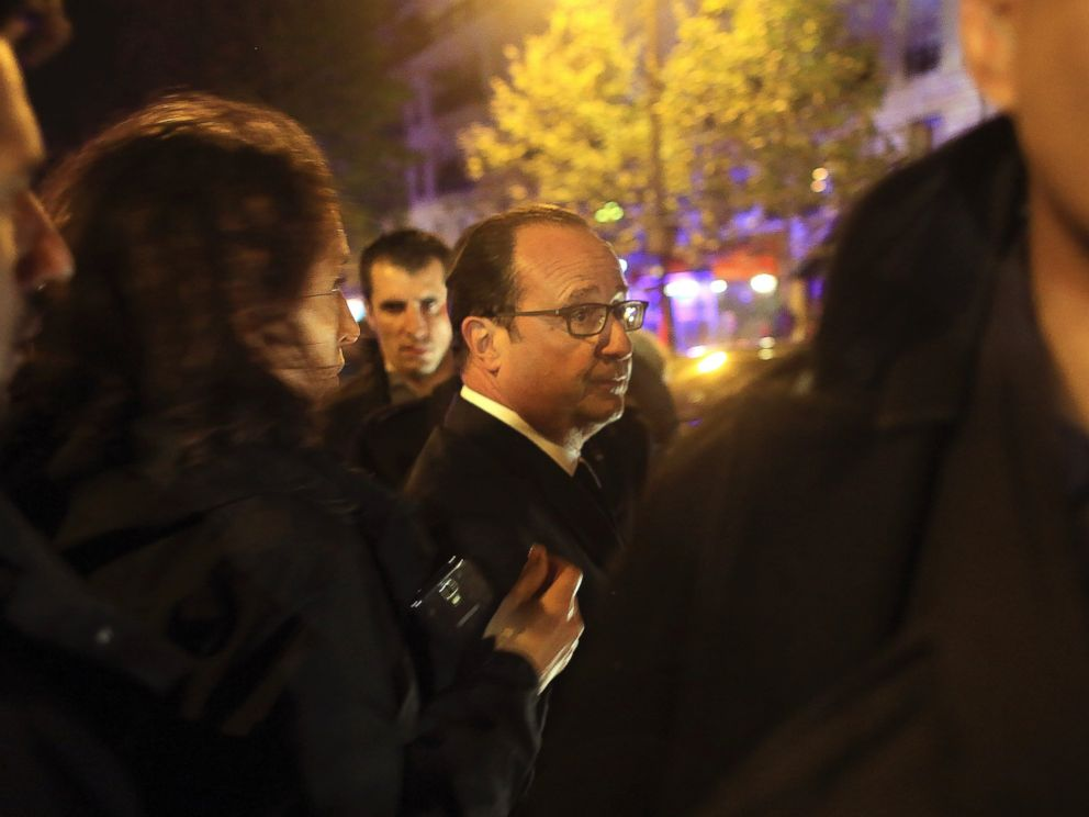 PHOTO: French President Francois Hollande arrives to visit the site of the the Bataclan theater after a shooting in Paris, Nov. 13, 2015.