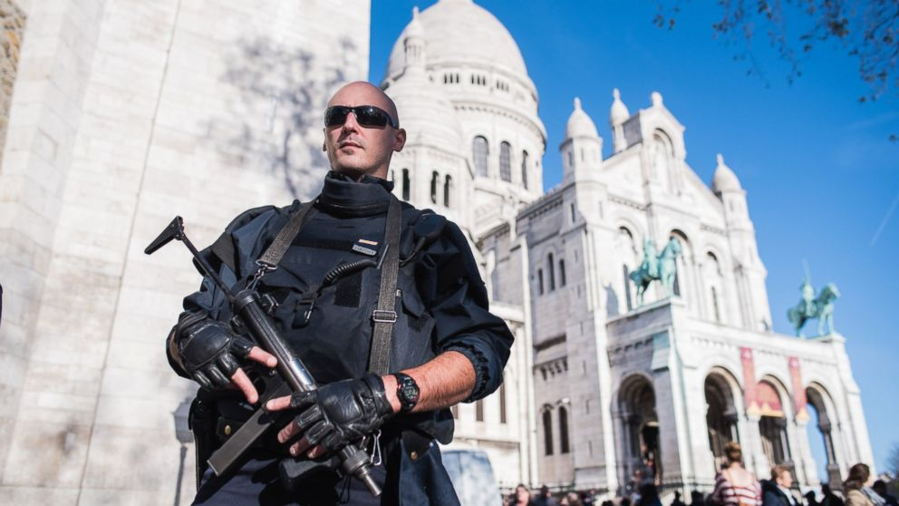 A French police officer patrols the Sacre Coeur basilica in Paris on Nov. 15, 2015.