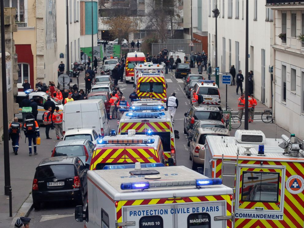 PHOTO: Ambulances gather in the street outside the French satirical newspaper Charlie Hebdos office, in Paris, Jan. 7, 2015.