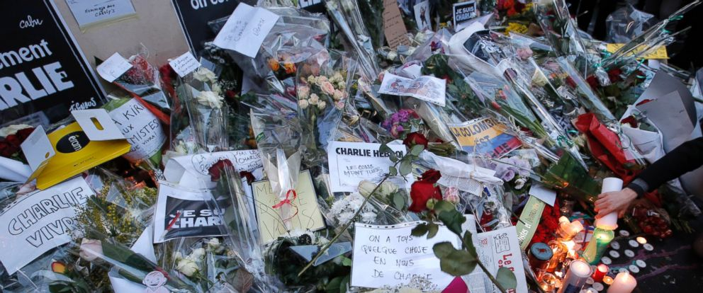 PHOTO: Flowers and candles are seen outside the office of Charlie Hebdo newspaper in Paris, Jan.8, 2015.
