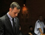 PHOTO: Olympic athlete Oscar Pistorius stands inside the court as a police officer looks on during his bail hearing at the magistrate court in Pretoria, South Africa on Feb. 20, 2013.