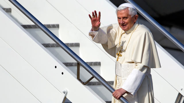 PHOTO: Pope Benedict XVI waves as he boards a plane on his way to a six-day visit to Mexico and Cuba, at Romes Fiumicino international airport on March 23, 2012.