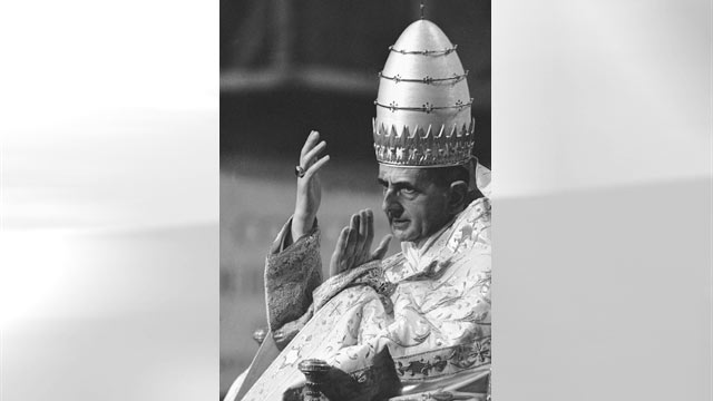 PHOTO: Pope Paul VI, wearing full pontifical robes and the papal tiara, raises his hands in answer to a cheering crowd while being carried from St. Peter's Basilica on his portable throne after a solemn Mass in the Basilica which celebrated the first anni