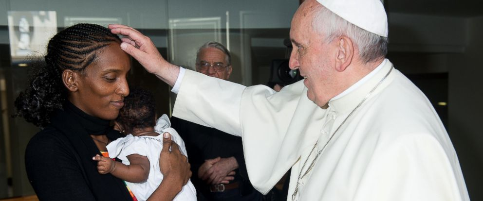 PHOTO: Pope Francis meets Meriam Ibrahim with her husband Daniel Wani and two small children in his Santa Marta residence at the Vatican on July 24, 2014.