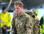 PHOTO: Britains Prince Harry, right, disembarks from a Voyager transport aircraft following its arrival at RAF Brize Norton, England, Jan. 23, 2013.