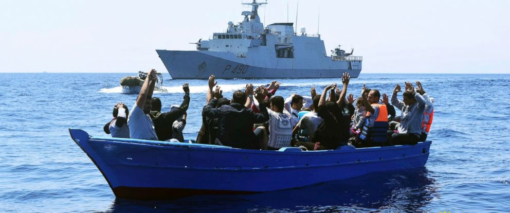 PHOTO: Migrants raise their arms as they are rescued at sea by the Italian Navy Marina Militare Fulgosi vessel in this image made available Tuesday, Aug. 2, 2016.