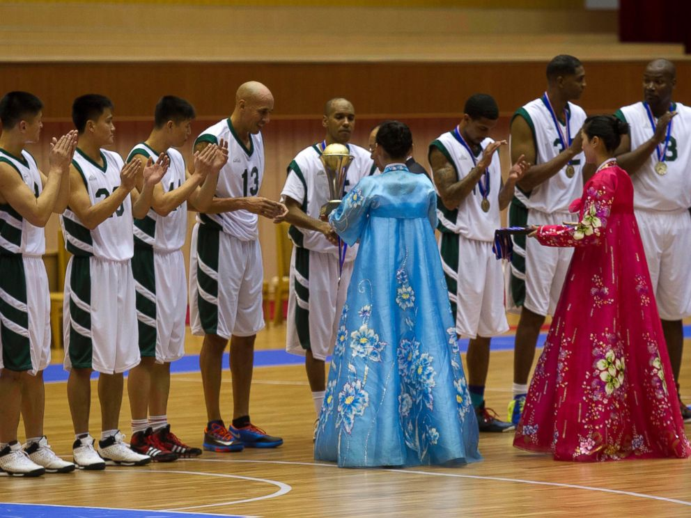 PHOTO: U.S. basketball player Doug Christie is handed a trophy as North Korean players applaud at the end of an exhibition basketball game at an indoor stadium in Pyongyang, North Korea on Jan. 8, 2014.
