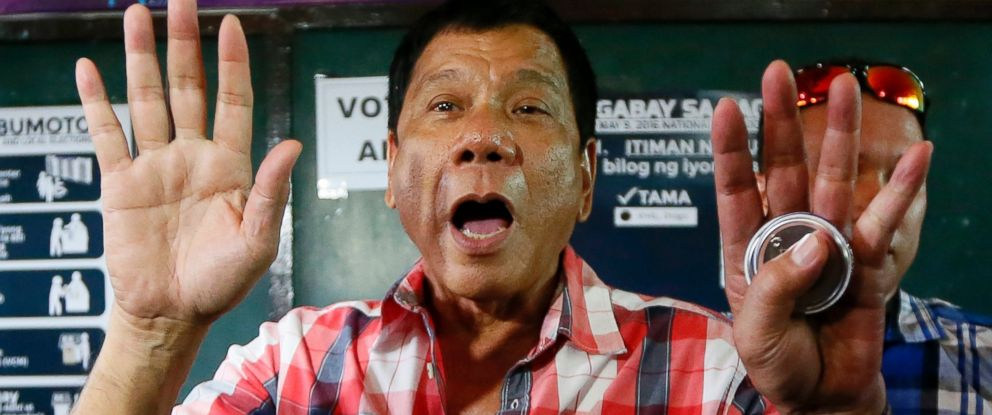PHOTO: Mayor Rodrigo Duterte gestures at photographers to move out prior to voting in a polling precinct at Daniel R. Aguinaldo National High School at Matina district, his hometown in Davao city in southern Philippines, May 9, 2016.
