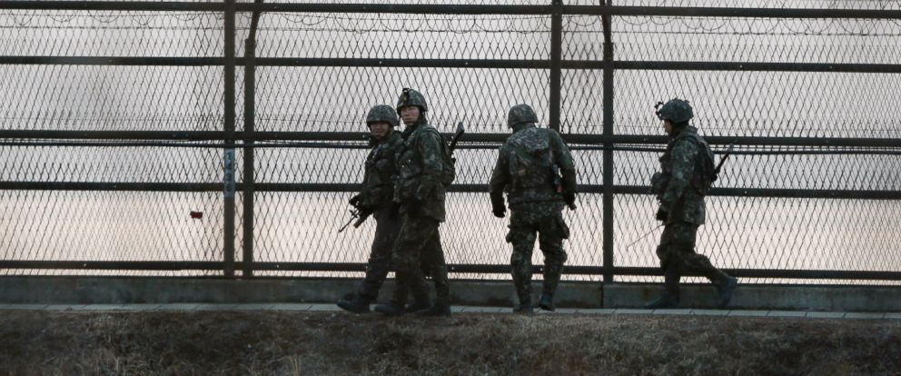 PHOTO: South Korean army soldiers patrol along a barbed-wire fence near the demilitarized zone between the two Koreas in Paju, South Korea, March 2, 2015.