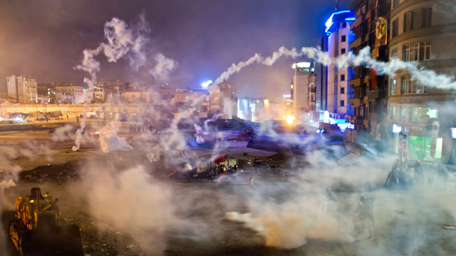 PHOTO: Taksim Square is flooded by tear gas as clashes between protesters and riot police continue into the night in Istanbul, June 11, 2013.