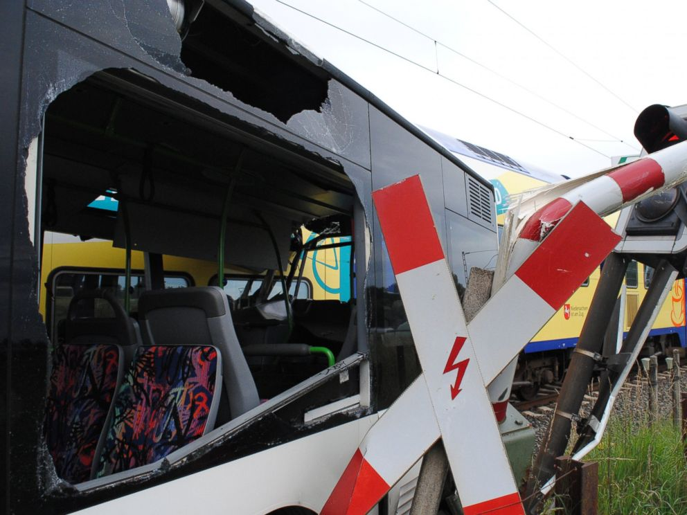 PHOTO: A demolished school bus is pictured next to a railway crossing where it was hit by a train in Helendorf, Germany, Sept. 16, 2015.