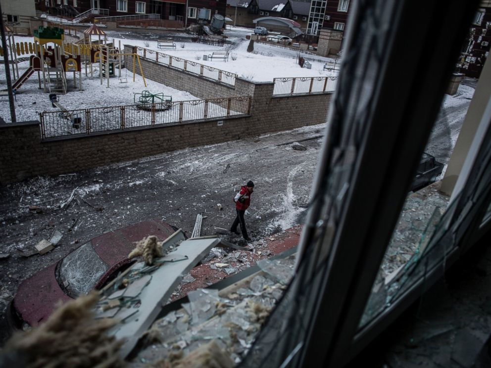 PHOTO: A Ukrainian man walks through the debris produced after the Ukrainian Army hit a building in Voroshilovsky area, center of Donetsk, Ukraine, Jan. 18, 2015.
