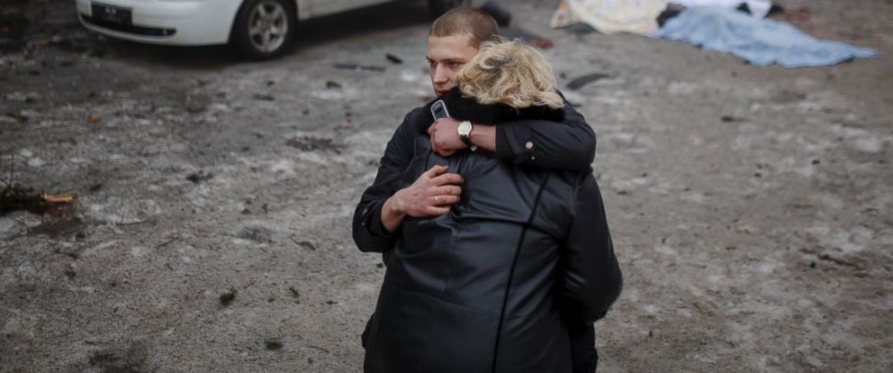 PHOTO: A rebel comforts the wife of a killed civilian in shelling in Donetsk, eastern Ukraine, Jan. 30, 2015.