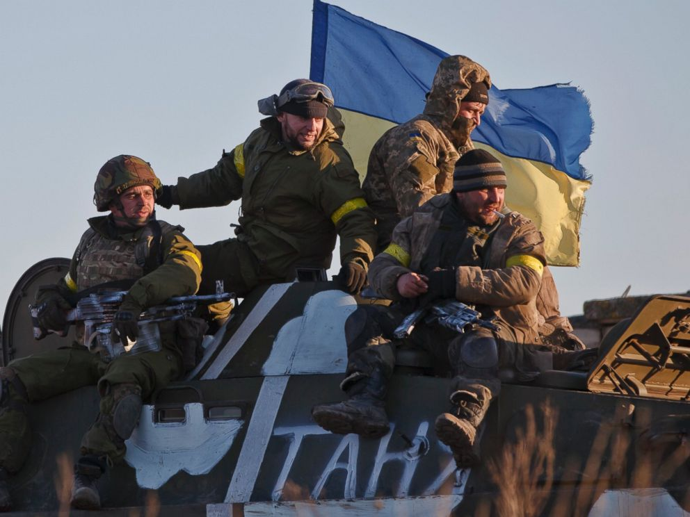 PHOTO: Ukrainian troops ride on an armored vehicle outside Artemivsk, Ukraine, while pulling out of Debaltseve, Feb. 18, 2015.