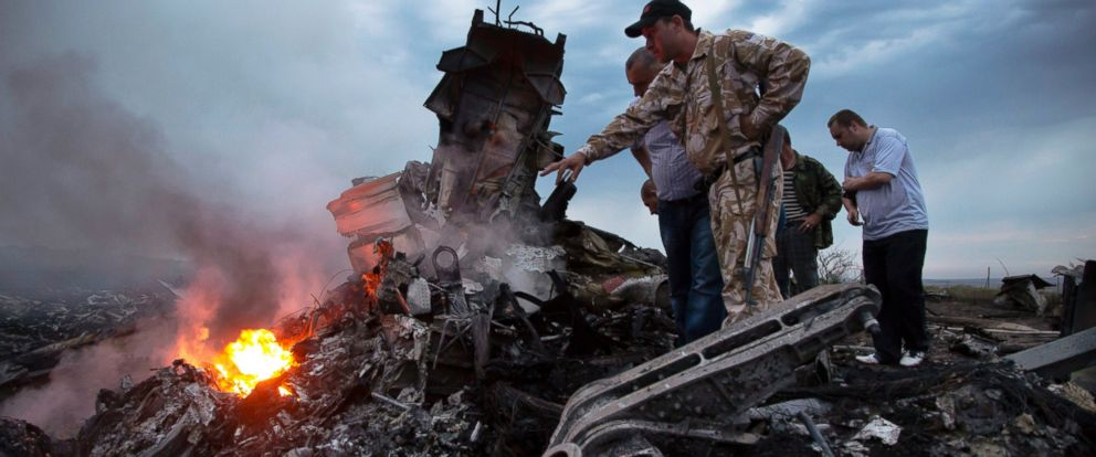 PHOTO: People inspect the crash site of Air Malaysia flight MH17 near the village of Grabovo, Ukraine, July 17, 2014.