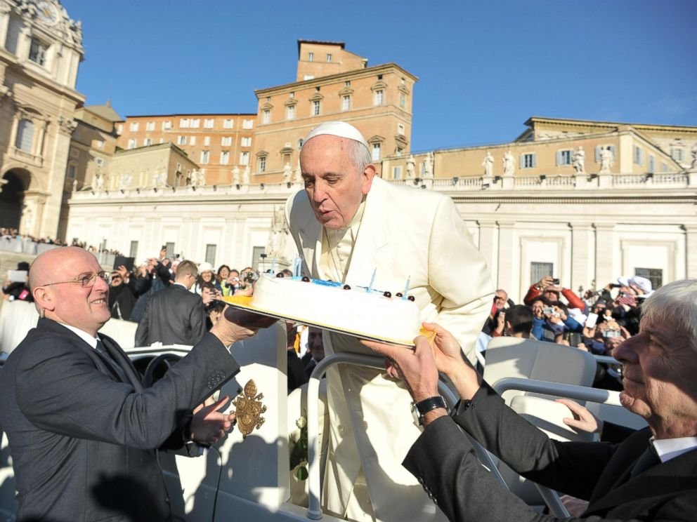 PHOTO: In this photo provided by Vatican newspaper LOsservatore Romano, Pope Francis blows candles on a cake during his weekly general audience in St. Peters Square at the Vatican on Dec. 17, 2014.