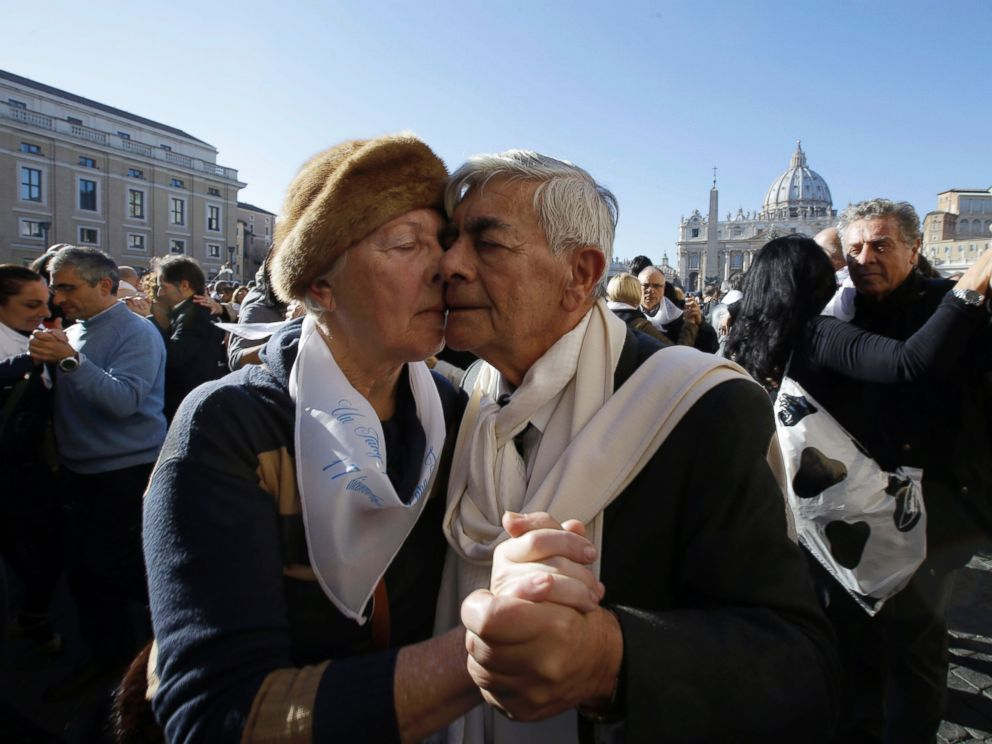 PHOTO: A couple dances tango in front of St. Peters Square to celebrate Pope Francis 78th birthday, at the Vatican on Dec. 17, 2014.
