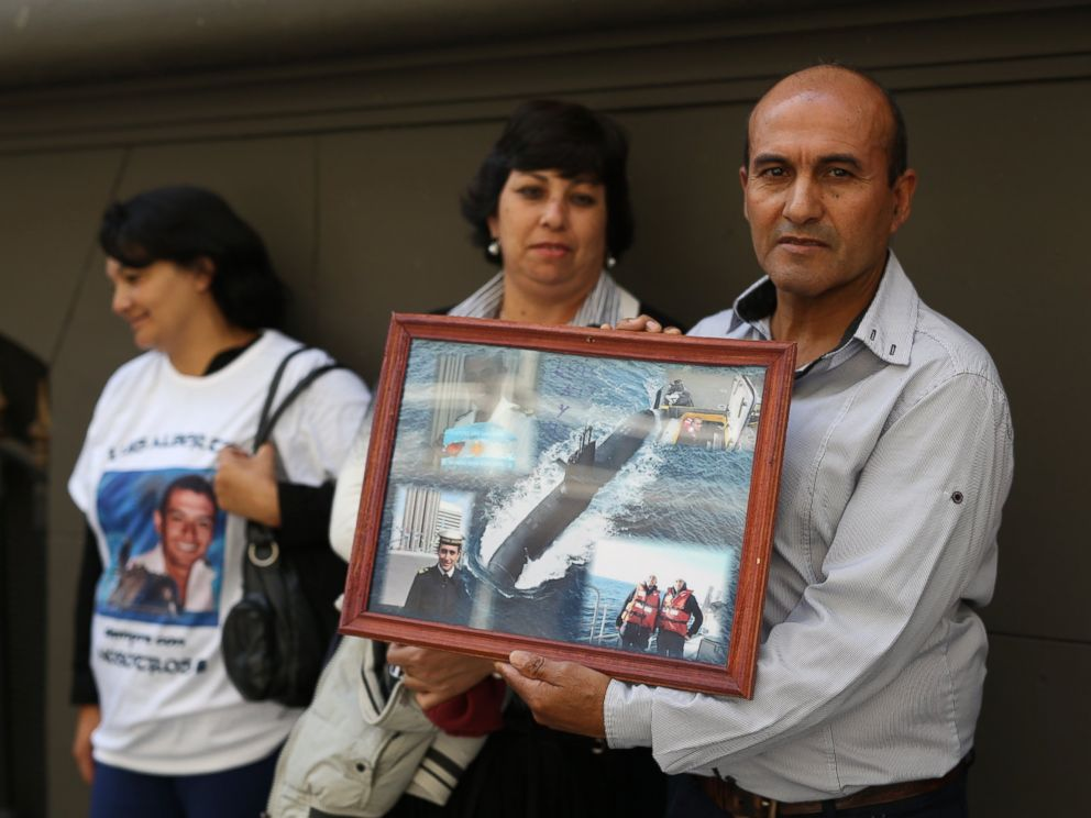 PHOTO: Antonio Niz, father of first Corporal Luis Niz, holds a collage of images of his son, a crew member of the missing ARA San Juan submarine, as family members stand outside Russias embassy in Buenos Aires, Argentina, Monday, Jan. 15, 2018.