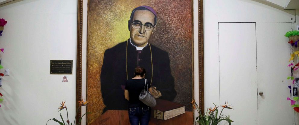 PHOTO: A woman prays in front of a portrait of the late Archbishop of San Salvador Oscar Arnulfo Romero prior of his canonization in San Salvador, El Salvador, Oct. 12, 2018.