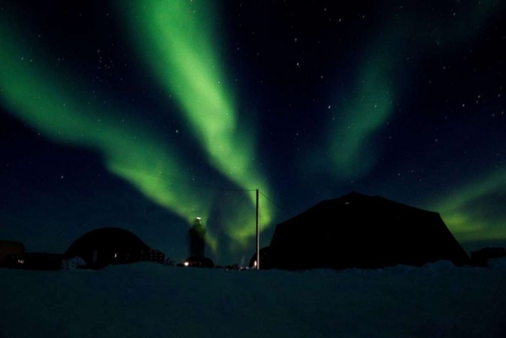 PHOTO: Ice Camp Skate as the aurora borealis displays above camp March 9, 2018 in support of Ice Exercise (ICEX) 2018.