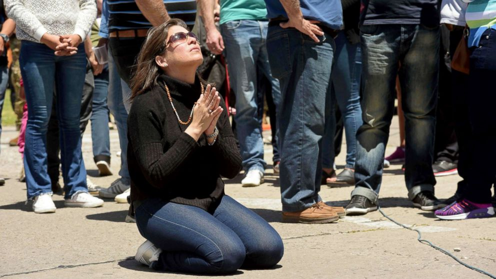 A relative of missing Argentine submarine crew member Celso Oscar Vallejos kneels down to pray, outside Argentina's Navy base in Mar del Plata, on the Atlantic coast south of Buenos Aires, on Nov. 25, 2017.
