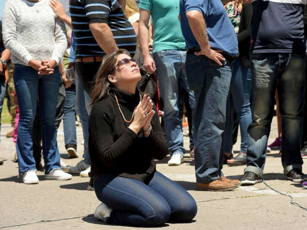 PHOTO: A relative of missing Argentine submarine crew member Celso Oscar Vallejos kneels down to pray, outside Argentinas Navy base in Mar del Plata, on the Atlantic coast south of Buenos Aires, on Nov. 25, 2017.