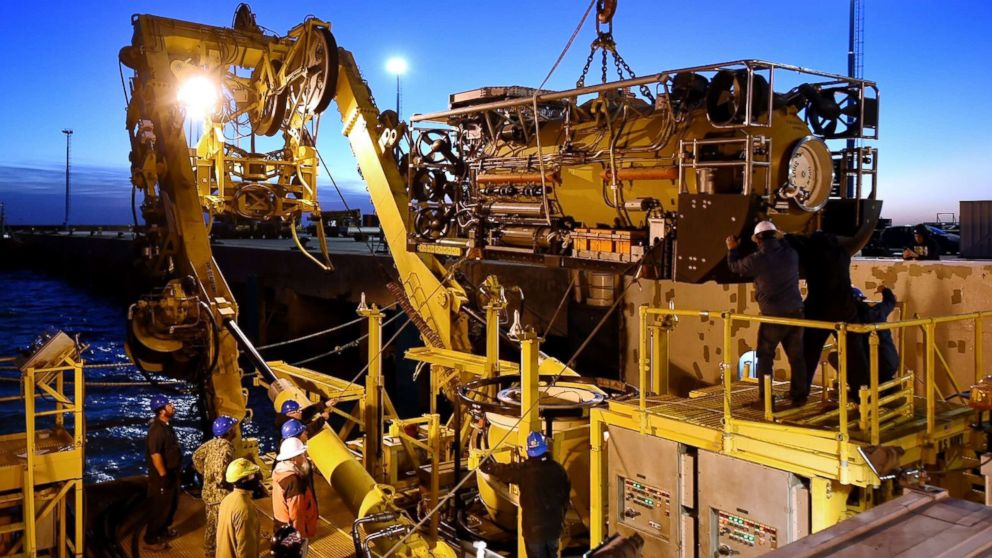 This handout picture released by U.S. Navy shows Undersea Rescue Command (URC) and Argentine construction workers preparing the motor vessel Sophie Siem for the installation of the Submarine Rescue Diving and Recompression System (SRDRS) to support the Argentine government's search and rescue efforts for the submarine ARA San Juan in Comodoro Rivadavia, Chubut, Argentina on Nov. 26, 2017.
