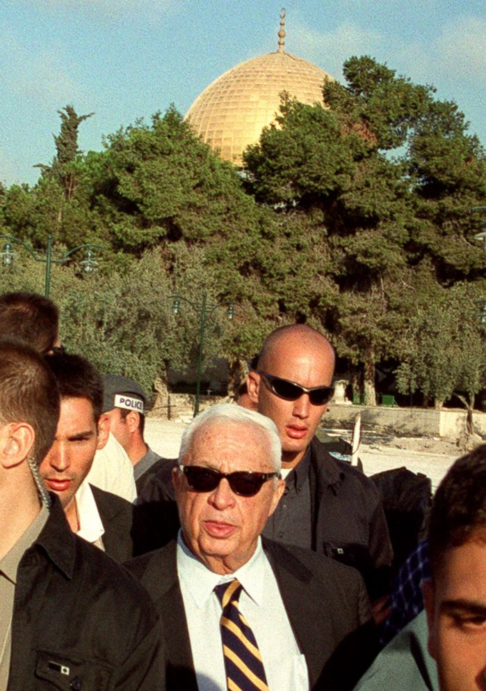 PHOTO: Ariel Sharon, center, is flanked by security guards as he visits the Al-Aqsa mosque compound in Jerusalems Old City, Sept. 28, 2000.