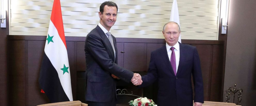 PHOTO: Russian President Vladimir Putin, right, shakes hand with Syrian President Bashar Assad in the Bocharov Ruchei residence in the Black Sea resort of Sochi, Russia, Nov. 20, 2017.