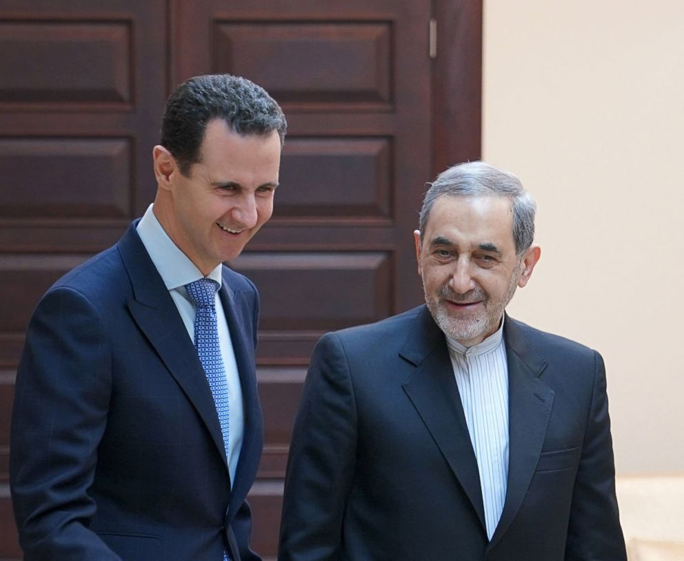 PHOTO: Syrian President Bashar Assad (L) receiving Ali Akbar Velayati (R), a top adviser to Irans Supreme Leader Ayatollah Ali Khamenei, in Damascus, Syria, April 12, 2018.