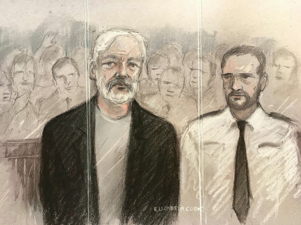 PHOTO: Court artist sketch depicting Julian Assange, left, as he appeared at Southwark Crown Court in London, May 1, 2019.