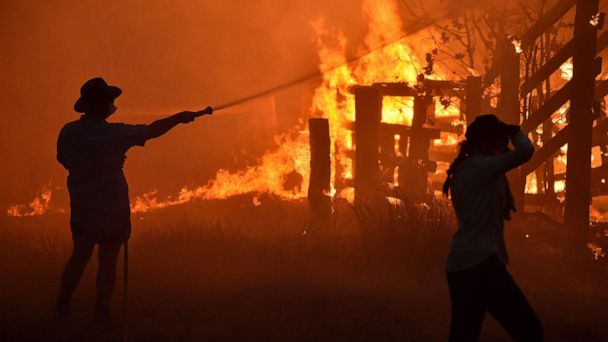 Firefighters save man's house from Australia wildfires - then apologize for drinking his milk