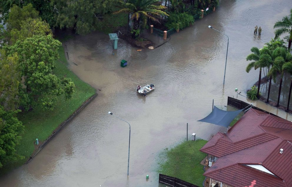 PHOTO: An aerial view shows residents leading a small boat through a flooded street in Townsville, Queensland, Australia, Feb. 4, 2019.
