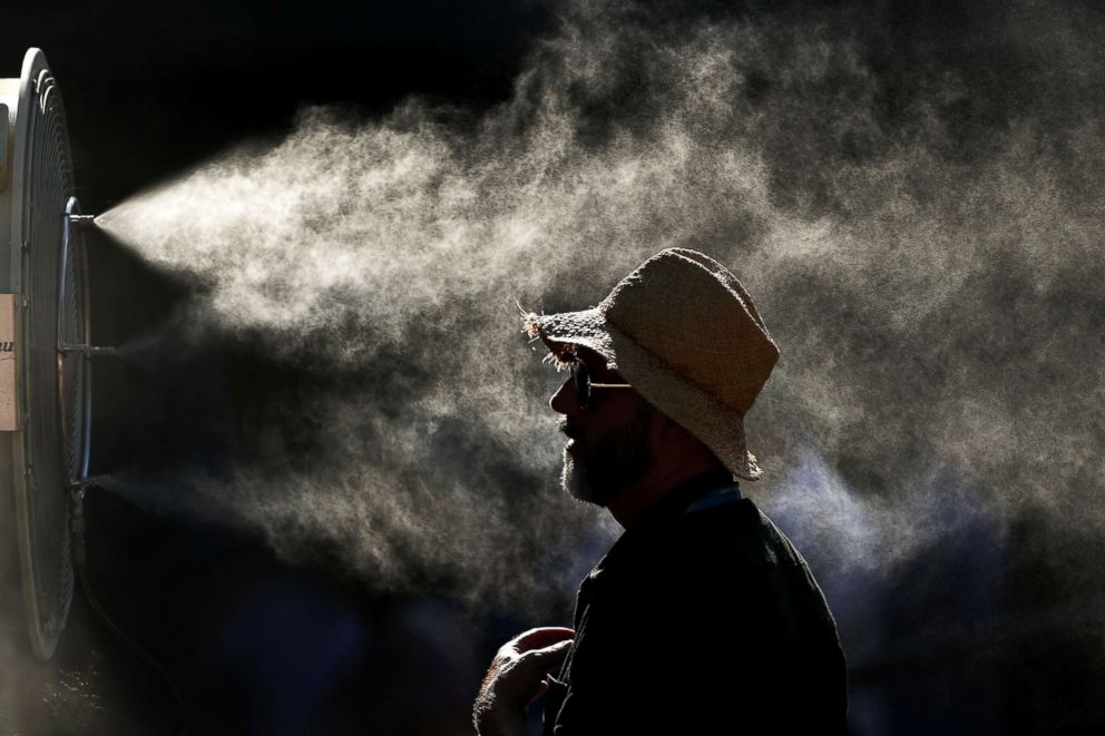 PHOTO: Fans cool off in the hot conditions at the 2019 Australian Open on Jan. 24, 2019, in Melbourne.