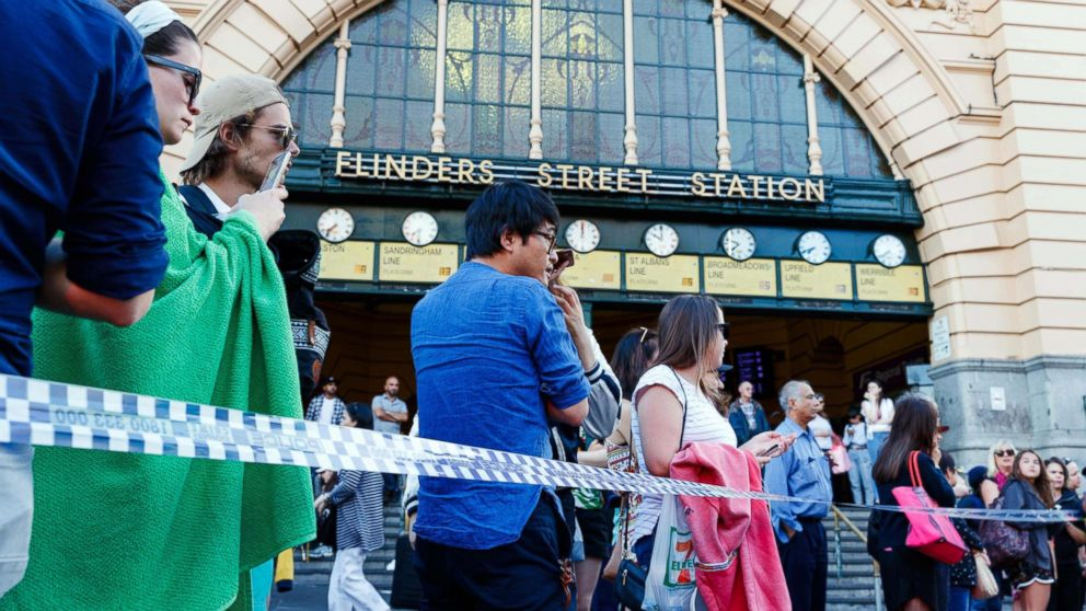 People gather at the scene of where a car ran over pedestrians at Flinders Street in Melbourne, Australia,  Dec.  21, 2017.