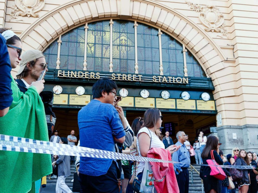 PHOTO: People gather at the scene of where a car ran over pedestrians at Flinders Street in Melbourne, Australia, Dec. 21, 2017.