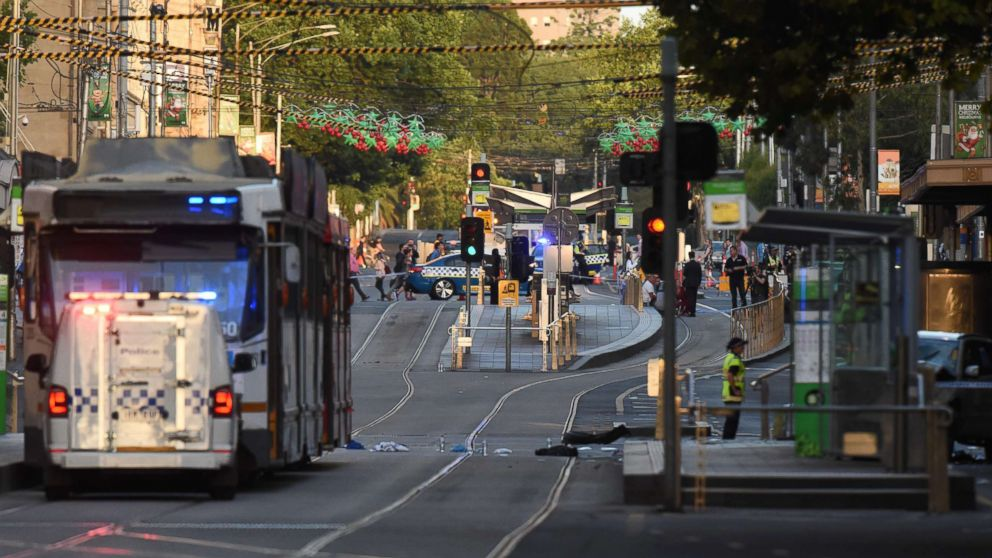 Debris sits in the middle of the road at the scene where a car ran over pedestrians in Melbourne, Australia, Dec. 21, 2017.