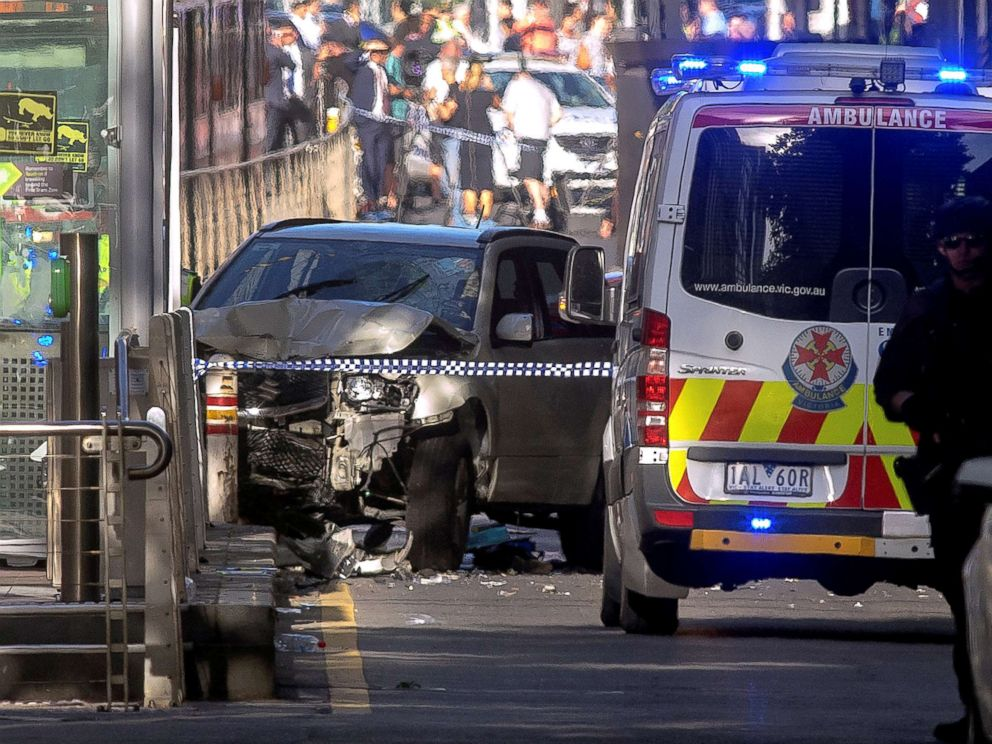 PHOTO: Australian police stand near a crashed vehicle after they arrested the driver of a vehicle that had rammed into pedestrians at a crowded intersection near the Flinders Street train station in central Melbourne, Australia, Dec. 21, 2017.