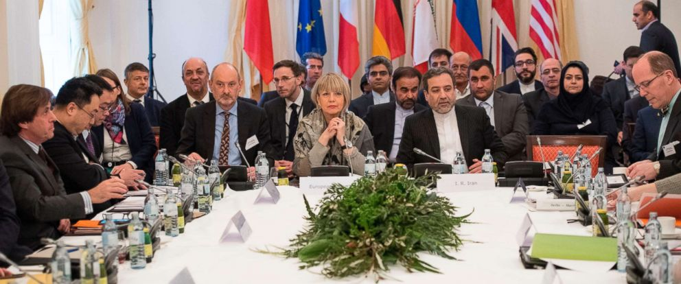 PHOTO: Abbas Araghchi (C-R), political deputy at the Ministry of Foreign Affairs of Iran, and the Secretary General of the European Union External Action Service (EEAS) Helga Schmid (C-L) along with delegates at Palais Coburg in Vienna, March 16, 2018.