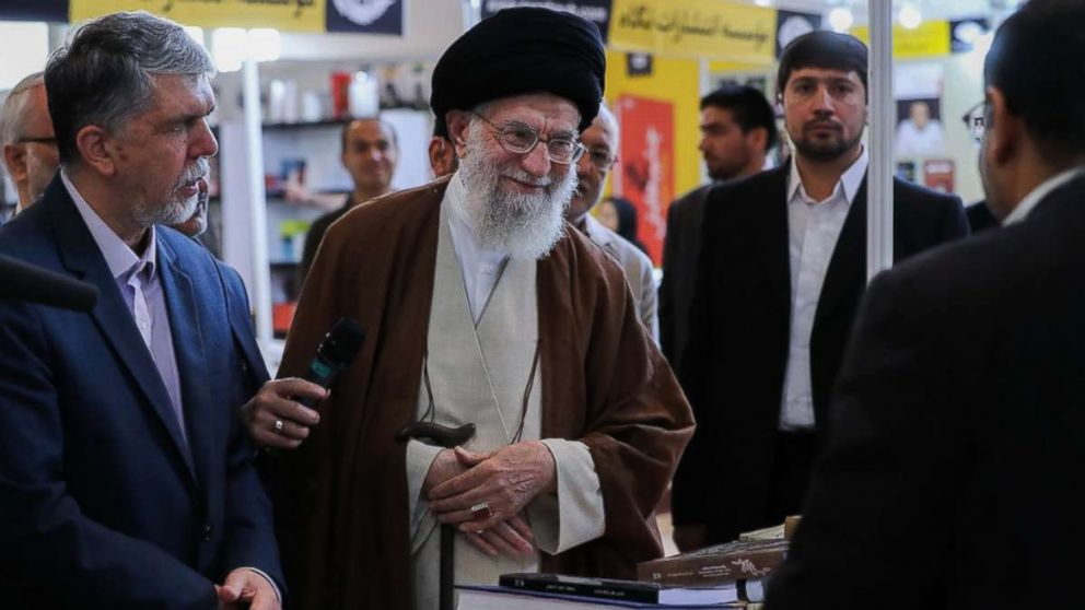 "Iran's Supreme Leader Ayatollah Ali Khamenei stopped by the 2018 Tehran International Book Fair and was photographed perusing a Farsi copy of the book ""Fire and Fury,"" by Michael Wolff, according to a post on his website on May 11, 2018."