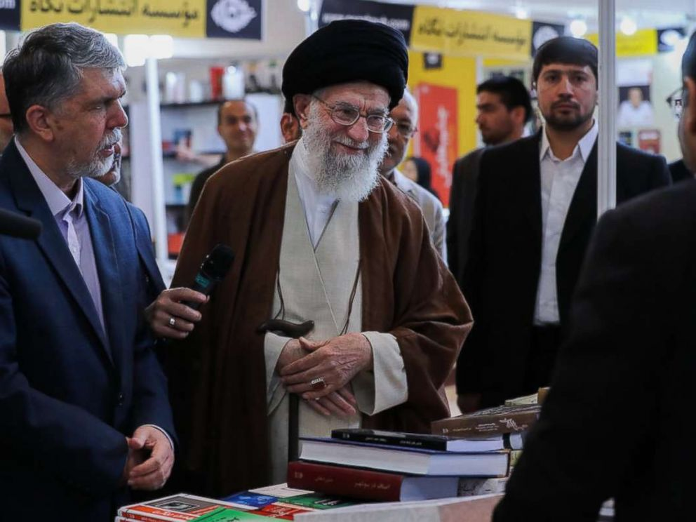 PHOTO: Irans Supreme Leader Ayatollah Ali Khamenei stopped by the 2018 Tehran International Book Fair and was photographed perusing a Farsi copy of the book Fire and Fury, by Michael Wolff, according to a post on his website on May 11, 2018.