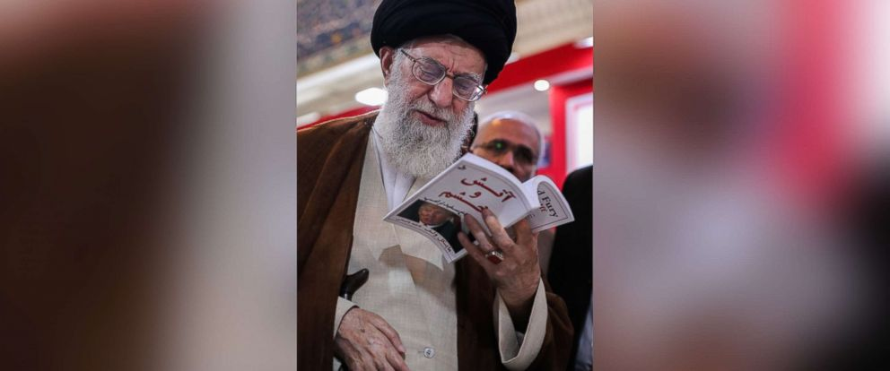 "PHOTO: Irans Supreme Leader Ayatollah Ali Khamenei stopped by the 2018 Tehran International Book Fair and was photographed perusing a Farsi copy of the book ""Fire and Fury,"" by Michael Wolff, according to a post on his website on May 11, 2018."