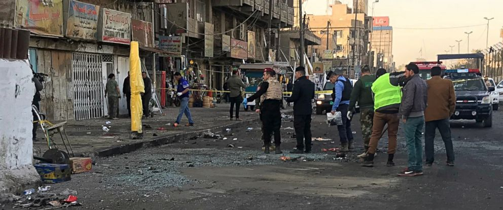 PHOTO: Iraqi security forces gather at the scene of a double suicide bombing in Baghdad, Iraq, Jan. 15, 2018.