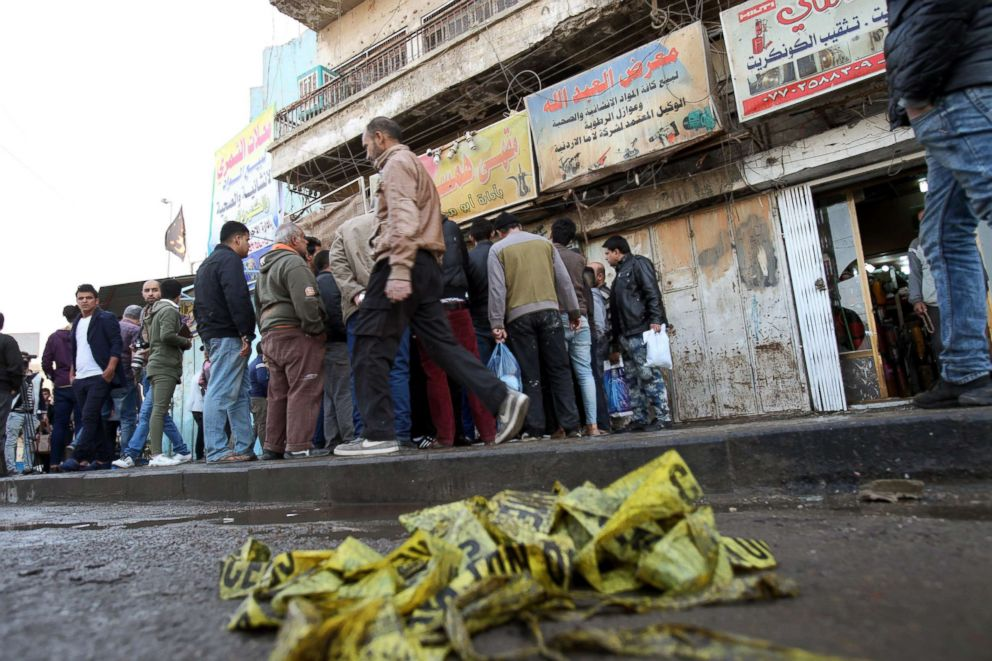 PHOTO: Local residents gather at the scene of double suicide bomb attack at Tayaran square, in central Baghdad, Iraq, Jan. 15, 2018.