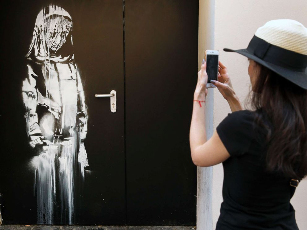 Thieves steal Banksy art from Paris IS attack venue