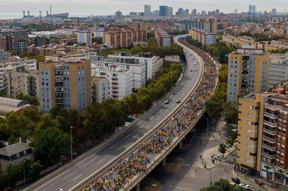 PHOTO: Pro-independence demonstrators march into the city on the fifth day of protests in Barcelona, Spain, Friday, Oct. 18, 2019.