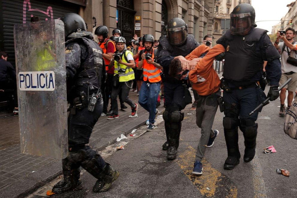 PHOTO: Police officers arrest a protester during a demonstration called by students, on October 18, 2019, on the day that separatists have called a general strike and a mass rally.