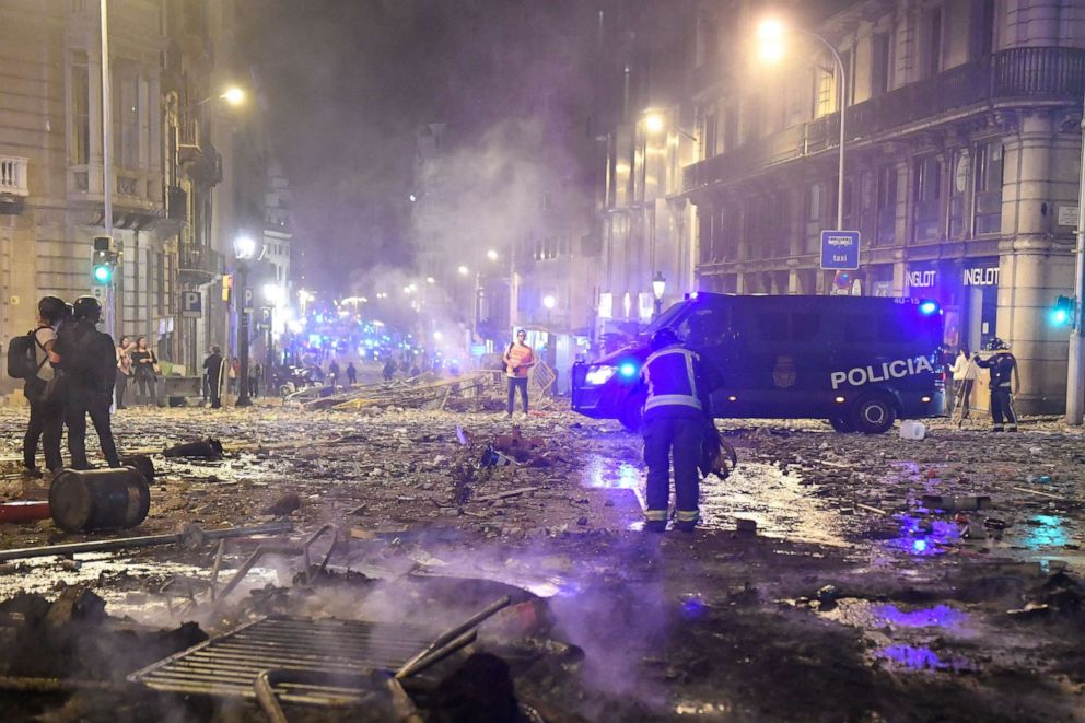 PHOTO: Burned debris are pictured in Barcelona, on October 18, 2019, after violence escalated during clashes, with radical separatists hurling projectiles at police, who responded with teargas and rubber bullets sparking scenes of chaos.