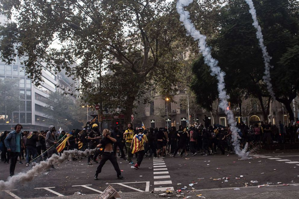 PHOTO: The police throw tear gas to the protesters, in Barcelona, Spain, on October 18, 2019.